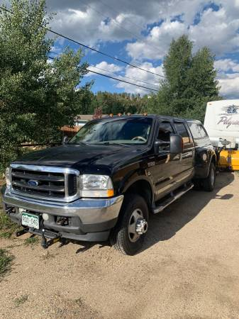 Photo 2003 F350 dually ford w plow - $9000 (Dillon)