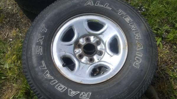 Photo 6 lug chevy silverado wheels and tires 2 sets of 4 - $100 (ROSEBURG)