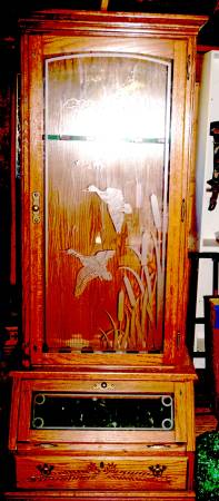 Photo Glass front 10 gun cabinet - $150 (Glide)