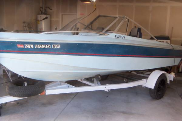 Photo 1984 EBCO 16 ft boat trailer and motor for sale - $2,750 (rio rancho)