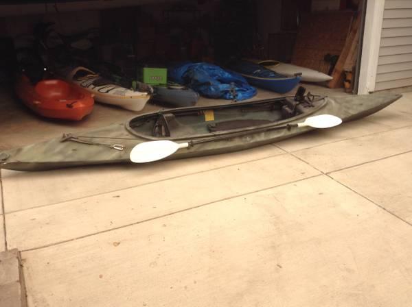 Photo 1439 Fishing kayak, steerable motor, Fish finder, and life vest - $650 (Sacramento)