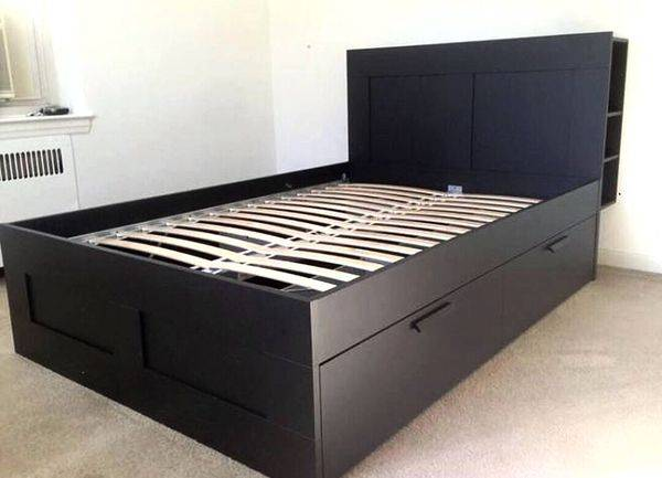 Photo Black king size Bed Frame with 4 drawers and bookshelf - $290
