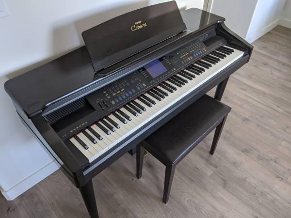 Photo Yamaha Clavinova Electric Piano - $100 (Midvale, UT)