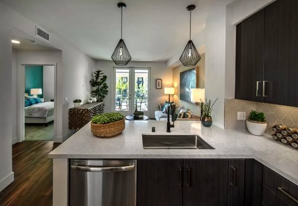 Photo Quartz Countertops, Full-Sized Appliances, Balcony, Garage Parking (7901 Civita Boulevard, San Diego, CA)