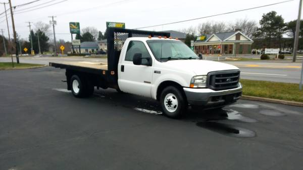 Photo 03 F350 SD, DUALLY FLAT BED, TURBO DIESEL,EXCELLENT SHAPE - $9,500 (HURON)