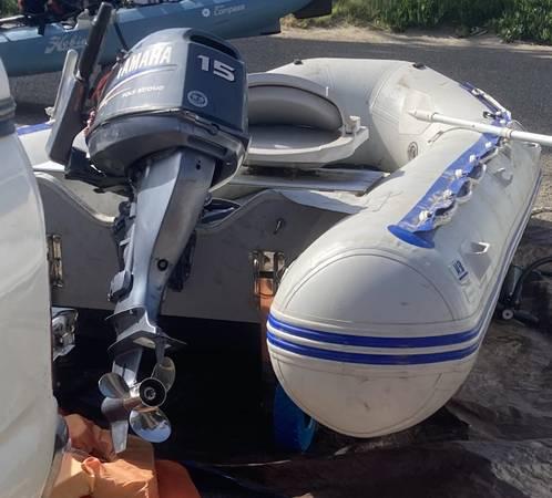Photo 14 ft inflatable boat with 15 HP Yamaha - $3,000 (Santa Barbara)