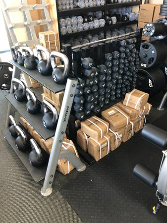 Photo Dumbbells - Olympic plates - lifting bars - adjustable weights  (Johnson Fitness  Wellness store - Thousand Oaks)