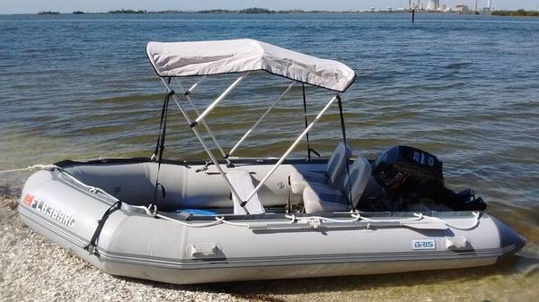 Photo 2020 1539 Inflatable boat on custom foldable aluminum trailer with 25hp - $1 (colorado springs)
