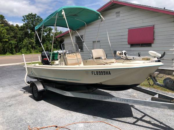 Photo 1996 scout 16.2 Sport fish center consul boat with a 75hp Mercury - $4,500 (Sarasota)