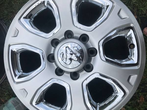 Photo 20 inch 8 lug Dodge Ram 2500 rims and two tires - $650 (Palmetto)