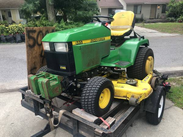 Photo John Deere 445 with trailer - $5,000 (Sarasota)