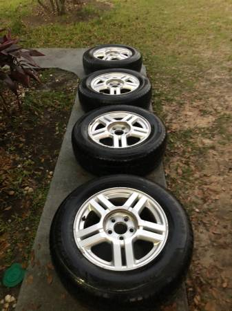 Photo Ford Rims and Tires like New - $250 (Jesup ga)