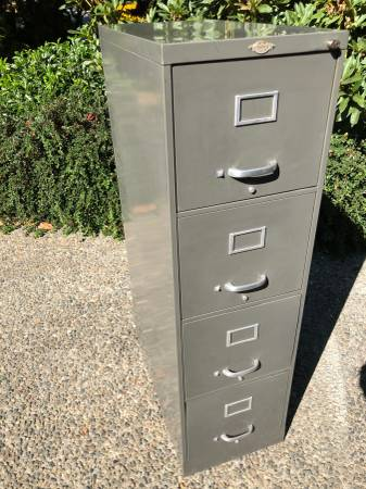 Photo 4 drawer letter size gray vertical file cabinet free hanging folders - $50 (Bellevue)