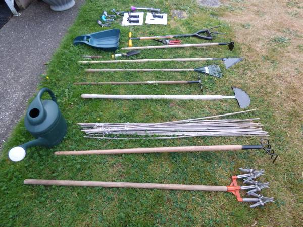 Photo Large selection of garden tools new used bamboo poles watering can - $30 (Bellevue)