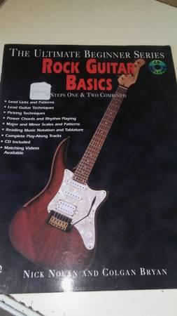 Photo Rock Guitar Basics book and CD - $5 (Downtown Everett)