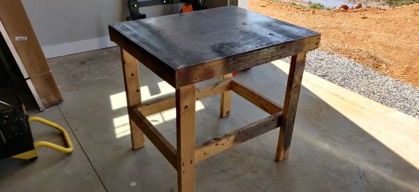 Photo Aluminum top workbench $30 or trade for 12 ft step ladder - $30 (Florence)