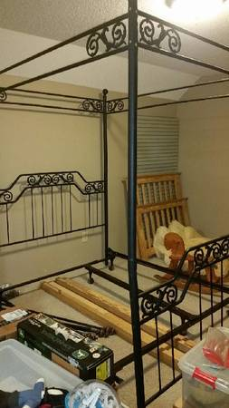 Photo Metal black canopy style bed frame - $125 (Tuscumbia)