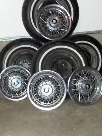 Photo 14quot GM steel rims , white wall tires, and factory wheel covers - $250 (Rural Hinton iowa)