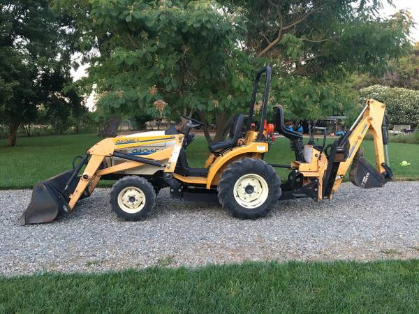 Photo 4x4 Diesel Cub Cadet Tractor with Loader and Backhoe - $13,500 (Red Bluff, CA)