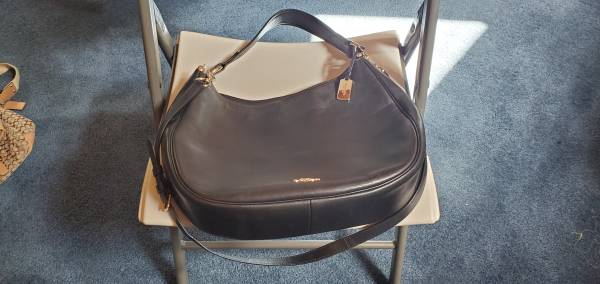Photo Coach black leather purse (brown leather interior) - $100 (ARLINGTON)