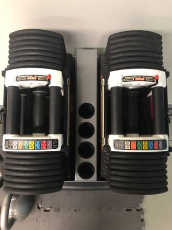Photo 90lbs Adjustable Powerblock Dumbbells wStand and Bench - $499