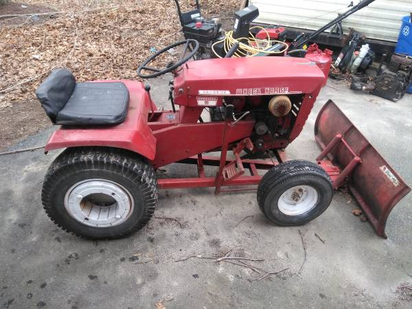 Photo Wheel horse garden tractor with snow plow and land plow (Swansea)