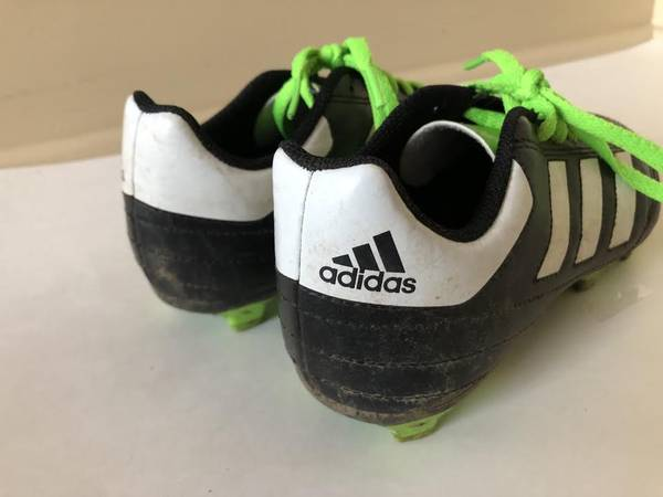 Photo helmets, football pads, Adidas cleats, goal (Washington TwpSewell)
