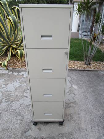 Photo 4 Drawer Rolling Metal File Cabinet with Wheels and Key - $75 (Port St. John, FL)
