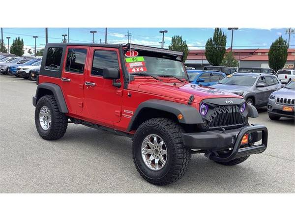 Photo 2010 Jeep Wrangler Unlimited Sport, Flame Red - $17000 (Spokane Valley)