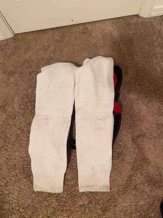Photo Ice hockey shin  shoulder pads - $30 (Spokane Valley)