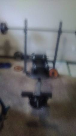 Photo Weight Bench w bar-bell, 2 dumbbells and 200 lbs. of weights39. Includs leg lift - $175 (Republic)