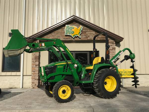 Photo TERRY (904) 460-4895 JOHN DEERE 3032E TRACTOR WITH POST HOLE DIGGER - $26,349 (Saint Augustine)