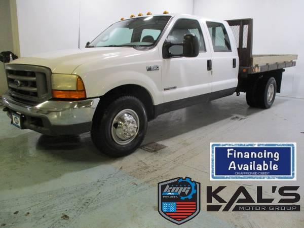 Photo 2000 Ford F350 XL 2WD crew cab diesel flatbed truck - $5990 (Wadena)