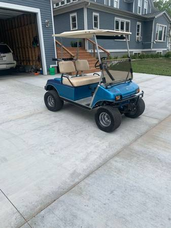 Photo Lifted golf cart - $2,600