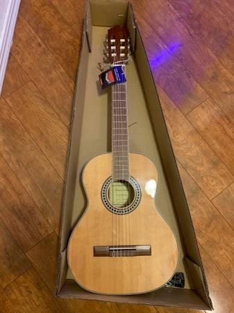 Photo 36 34 Hola Guitar - $105 (Broken Arrow)