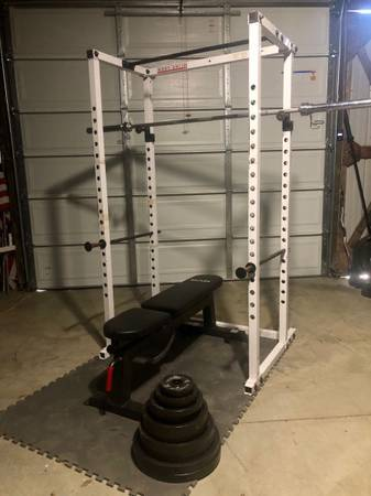 Photo Body solid power cage squat rack and bench with 300lb weight set - $600 (Saint Peters)