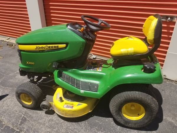 Photo John Deere X300 Riding Mower - Vtwin Kawasaki Engine - $775 (Creve Coeur)