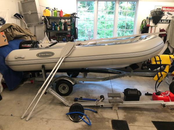 Photo 1239 Ridged Inflatable Boat, 4 Stroke Motor, Trailer, Beach dolly - $5900 (Charlevoix)