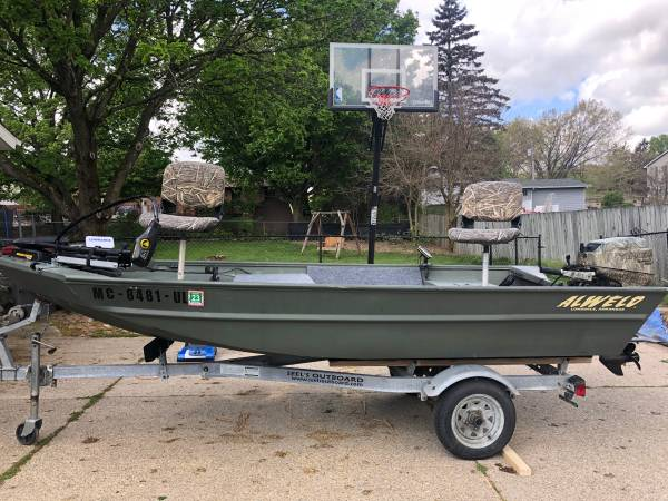 Photo 14 ft jon boat with 20 hp - $6,000 (Grand Rapids)