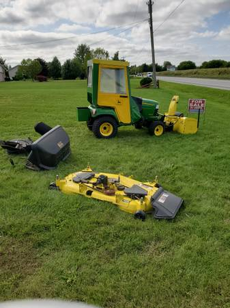 Photo John Deere X575 LawnGarden Tractor 4x4 With Cab, Deck and Bagger - $8,500 (Port Huron, Mi.)