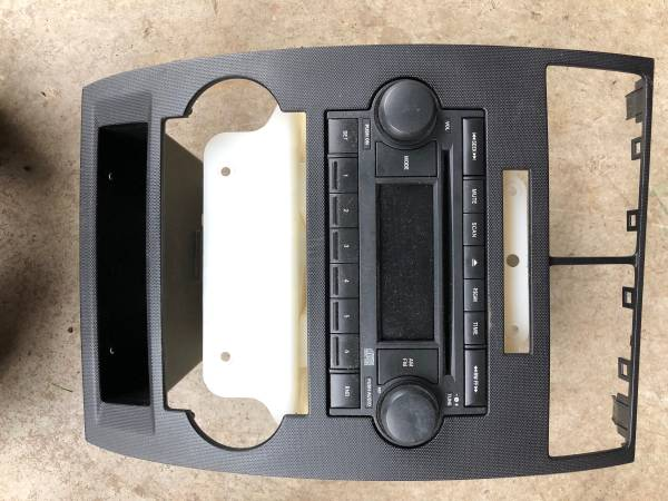 Photo Dodge radio out of 2005 Magnum with dash bezel - $60 (Fairmount)
