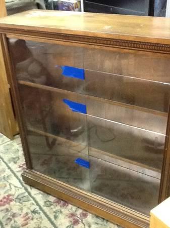 Photo Glass front bookshelf display - $75 (34609)