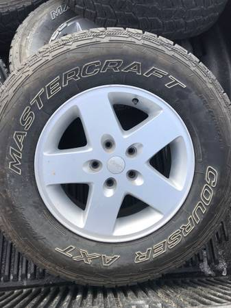 Photo 26570R17-Jeep Rims and NEW tires - $500