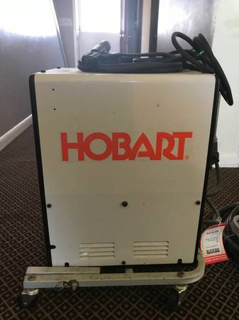 Photo New Hobart 235 and used Chicago Electric 225 with extensions and cart - $350