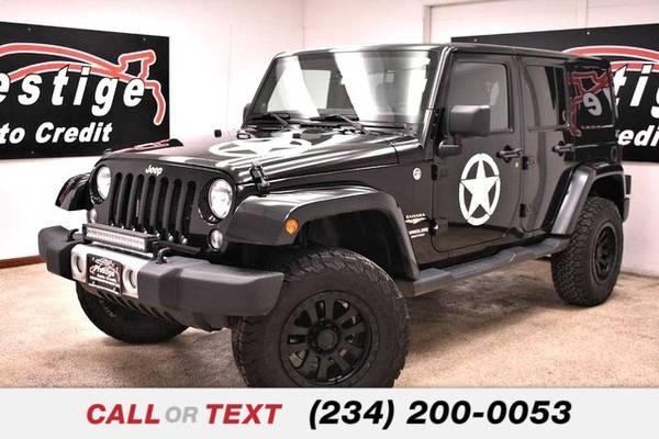 Photo 2014 Jeep Wrangler Unlimited Sahara - $22471 (Toledo)