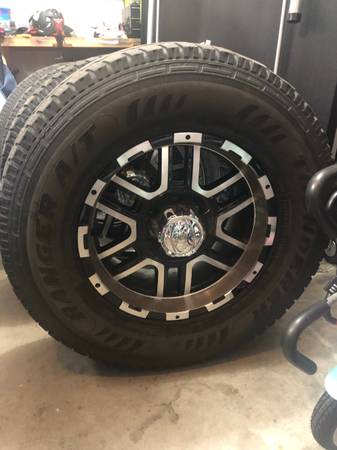Photo 17x8 wheels with 2857017 off Ford F150 - $350 (Topeka)