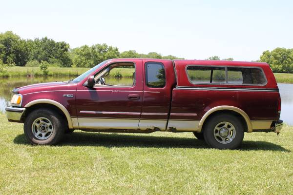 Photo 1997 Ford F150 extended cab with topper - $2,200 (Topeka)