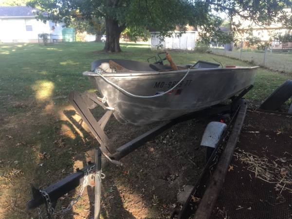 Photo Boat, Motor and Trailer All Have Clear Titles - $600 (Clinton, MO)