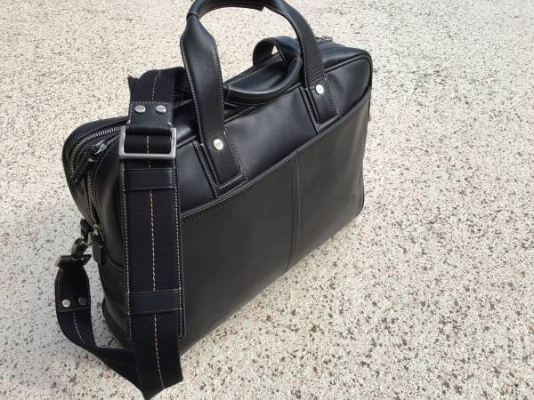 Photo Coach Leather Briefcase. Never used - $140 (Hobe Sound)