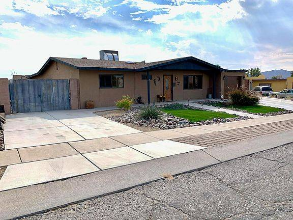 Photo Hi gh block walls, gated entry on each end of the home and a garage do (Tucson, AZ)